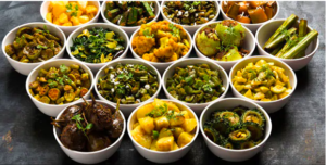 Indian vegetarian dishes displayed in multiple bowls